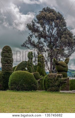 The Cemetery Of Tulcan Known For Elaborately Trimmed Cypress Bushes Inspired By Roman Incan Aztec And Egyptian Themes poster