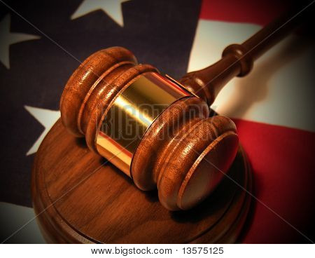 A photo of a gavel on the American flag