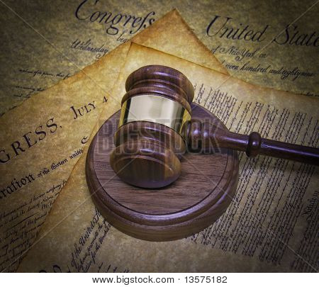 A photo of a gavel on historical documents