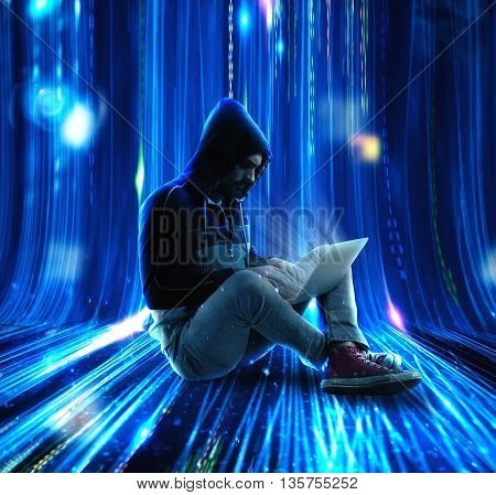 Man with hoodie writes to the computer