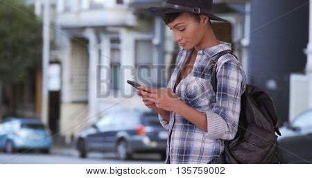 Pretty Hipster Woman Texting On Cell Phone In San Francisco Using Smartphone Sms App