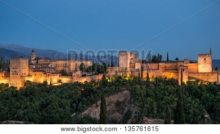 sunset views of the Alhambra and the sierra Nevada from el Mirador de San Nicolas Granada Andalucia Spain in Summer 2016