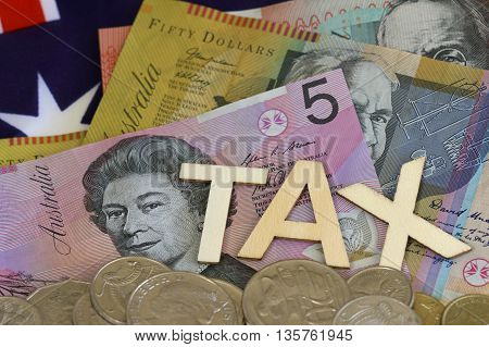 Taxation sign with Australian dollars and coins.