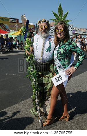 NEW YORK - JUNE 18, 2016: Participants march in the 34th Annual Mermaid Parade, the largest art parade in the nation and a celebration of ancient mythology and honky-tonk rituals of the seaside