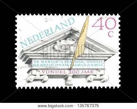 NETHERLANDS- CIRCA 1979 : Cancelled postage stamp printed by Netherlands, that shows Tympanum of the ancient theater of Amsterdam.