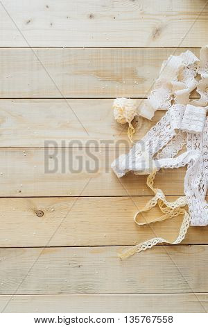 crafts concept lace ribbon on wooden background
