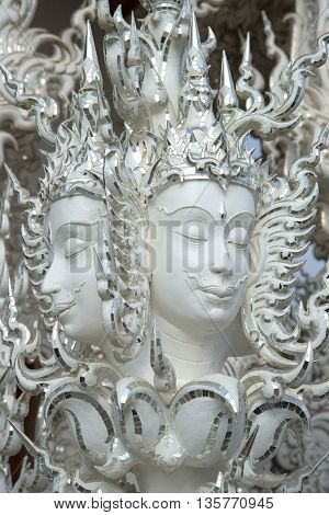 CHIANG RAI, THAILAND - JANUARY 14, 2014: Sculpture in the design of the White temple (Wat Rong Khun). Religious landmark  of the city Chiang Rai, Thailand
