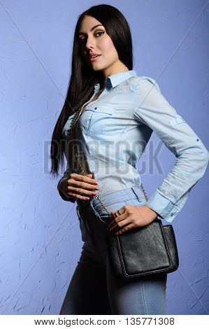 Fashion Stylish Brunette Girl In Jeans Looking At The Camera