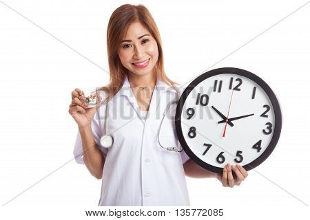 Young Asian Female Doctor Smile With A Clock And Pills In Hand