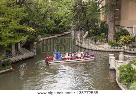 SAN ANTONIO USA - APR 11: Sightseeing boat at the famous San Antonio River Walk. April 11 2016 in San Antonio Texas United States