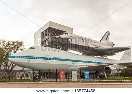 HOUSTON USA - APR 12: Space Shuttle Independence and Shuttle Carrier Aircraft 905 at the Johnson Space Center in Houston. April 12 2016 in Houston Texas United States