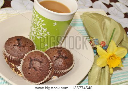 Chocolat muffins and a cup of coffee
