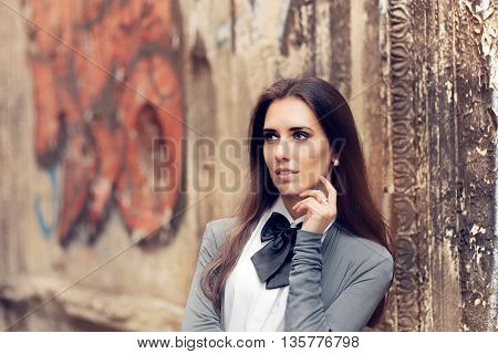 Romantic Urban Girl with Bowtie Accessory in Melancholic State of Mind