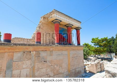Knossos palace with charging bull fresco on the background on the Crete island Greece.