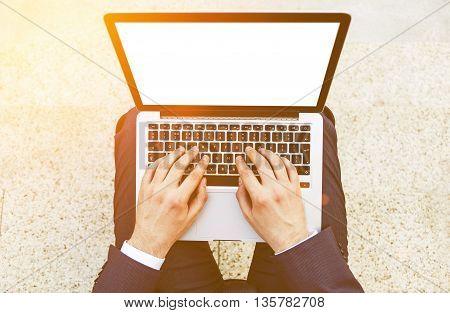 Businessman Using Laptop Toning