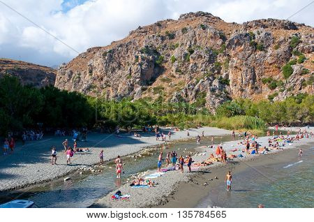 CRETEGREECE-JULY 23:Tourists have a rest on the Preveli Beach on July 232014 on Crete Greece. The beach of Preveli is situated 40 km south of the main town and is the most idyllic beach in Crete.