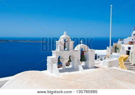 Oia Orthodox church on the edge of the Santorini caldera cliffs on the island of Thira (Santorini) Greece.