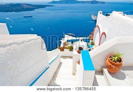 Steps down to the Idyllic patio in Fira on the island of Thera(Santorini) Greece.
