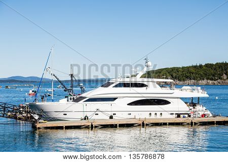 A white luxury yacht docked in Bar Harbor Maine