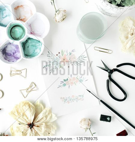 flat lay floral watercolor painting with bow tie clips scissors dry tulip roses palette succulent on white background. top view