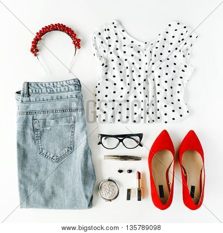 flat lay feminine clothes and accessories collage with shirt jeans glasses mascara lipstick red high heel shoes earrings and hoop on white background.