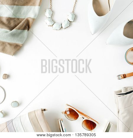 flat lay feminine clothes and accessories collage with cardigan trousers sunglasses watch bracelet lipstick mint high heel shoes earrings and purse on white background.