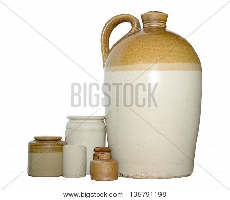 Earthenware flagon with mixed pots worn from age on an isolated white background with a clipping path