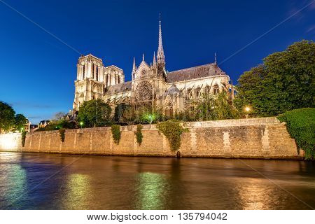 The river Seine and Notre Dame cathedral in Paris at night