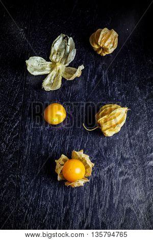 Closeup Orange Organic Cape Gooseberries On Wooden Background