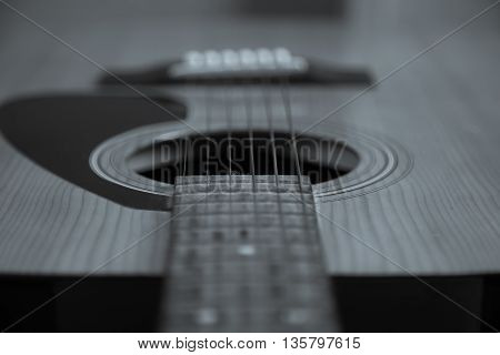 Guitar Strings close up. Acoustic guitar. Black and white shallow focus