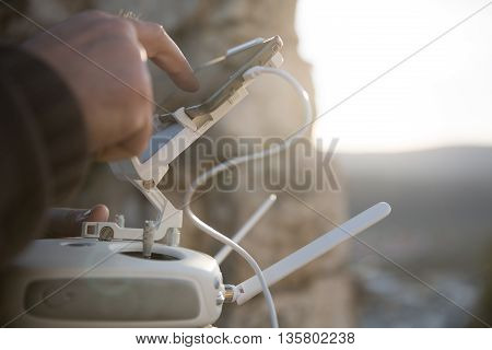 Drone remote control in hand man.Man operating of flying drone