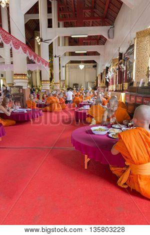 Buddhist Monk Eat Lunch In Asian Temple