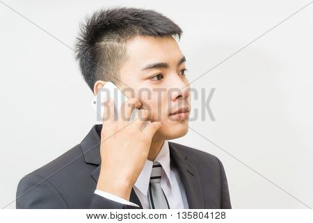 Handsome Business Asian Man In Black Suit Speaking On The Phone