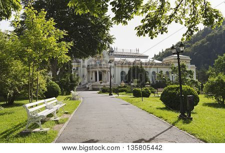 Sinaia, ROMANIA - June 18 2016: Street towards the Sinaia Casino, which was built at the initiative of King Carol I of Romania. SINAIA - June 18 2016