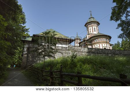 Sinaia, ROMANIA - June 18 2016: Sinaia monastery seen from a back alley in a peaceful atmosphere. SINAIA - June 18 2016