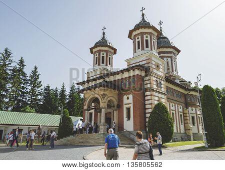 Sinaia, ROMANIA - June 18 2016: The yard of Sinaia monastery filled with tourists. SINAIA - June 18 2016