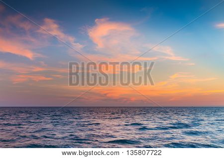 Skyline over seacoast with sunset sky and cloud background