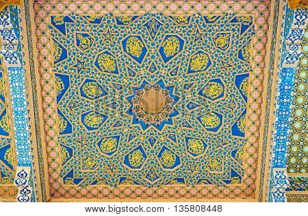 BUKHARA UZBEKISTAN - APRIL 29 2015: The carved wooden screen on ceiling of Sheikh Naqshband Mausoleum decorated with painted stellar geometric and floral patterns on April 29 in Bukhara.