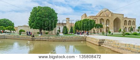 BUKHARA UZBEKISTAN - APRIL 29 2015: The Khanaka of Abd Al-Aziz-Khan located adjacent to the medieval mosques mausoleum and cemetery on April 29 in Bukhara.