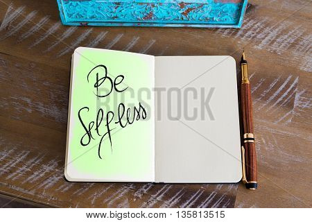 Handwritten Text Be Selfless over notebook, copy space available