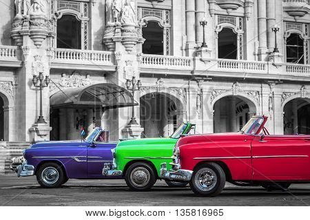 Colorful american cabriolet classic cars parked in Havana Cuba