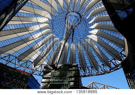 Berlin Germany - June 192010: Fibre glass elliptical roof with white sails designed by Helmut Jahn at the SONY Center in Berliner Platz