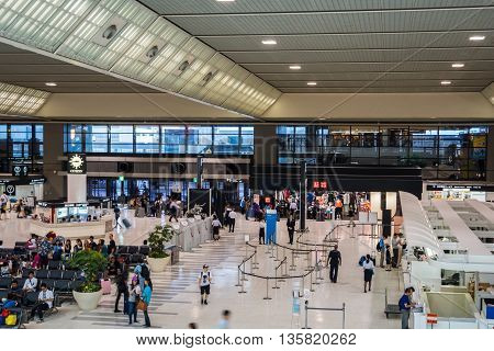 TOKYO, JAPAN - circa JUNE 2016: Passengers checking in at terminal 2  departure area at  Narita International Airport, Tokyo, Japan.  Narita Airport, also known as Tokyo Narita Airport, is an international airport serving the Greater Tokyo Area of Japan.