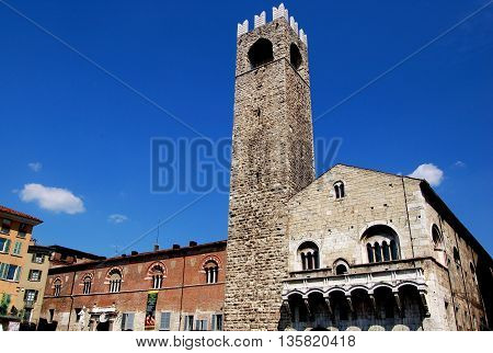 BRESCIA ITALY: 13-17th centuries Broletto with its soaring stone 1187-1234 stone campanile the Tor del Pegol in the Piazza del Duomo