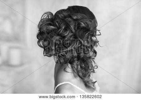 Studio portrait of beautiful bride's hairstyle. Stock photo.