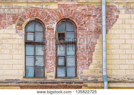 Two windows on facade of Petersburg Art XX-XXI Centuries Museum St. Petersburg Russia