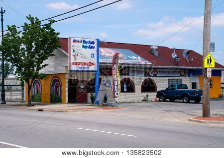 JOLIET, ILLINOIS / UNITED STATES - JUNE 3, 2015: A large sign indicates the Direct Thy Path Day Care II to be directly behind the Doña Chelo Mexican restaurant in downtown Joliet.