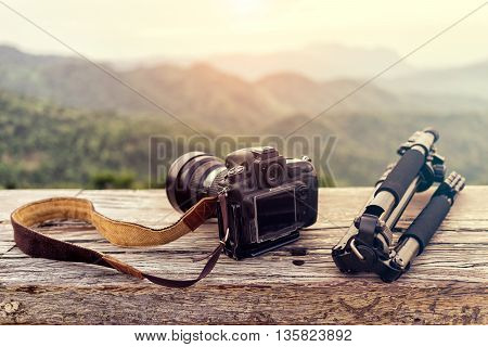 Travel photographer equipment with beautiful landscape on the background Traveling and Relax Concept.