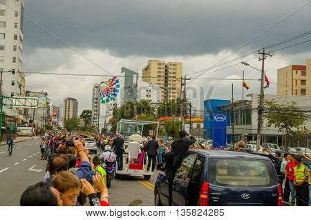 QUITO, ECUADOR - JULY 7, 2015: Pope Fracisco visiting Ecuador, popemobile on Quito streets, view from behind.