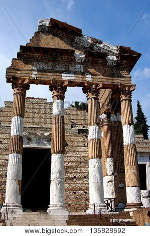 Brescia, Italy - May 30, 2006: Stately fluted Corinthian column ruins of the Temple of Vespasian in the ancient Roman Forum (69-96 A.D.)